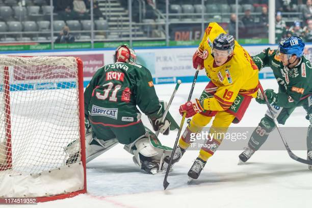goalkeeper Olivier Roy of Augsburger Panther Luke Adam of Dueseldorfer EG and Patrick McNeill of Augsburger Panther battle for the ball during the...