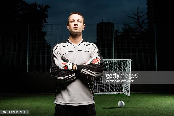 Goalkeeper on football pitch, portrait