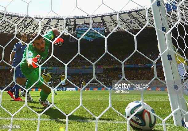 Goalkeeper Orestis Karnezis of Greece fails to save a shot by Pablo Armero of Colombia for his team's first goal during the 2014 FIFA World Cup...