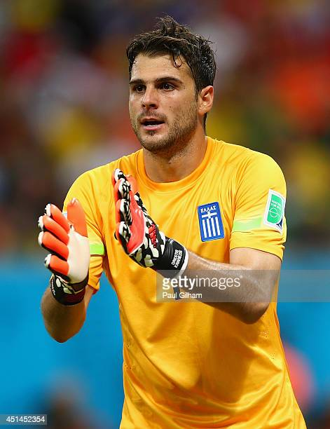 Goalkeeper Orestis Karnezis of Greece gestures during the 2014 FIFA World Cup Brazil Round of 16 match between Costa Rica and Greece at Arena...