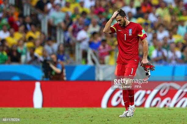 Goalkeeper Orestis Karnezis of Greece walks off the field during the 2014 FIFA World Cup Brazil Group C match between Greece and Cote D'Ivoire at...
