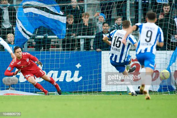 Goalkeeper Oscar Whalley of AGF Arhus does not save the penalty kick from Nicklas Helenius of OB Odense during the Danish Superliga match between OB...