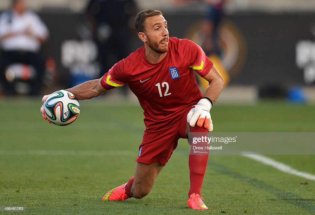 Goalkeeper Panagiotis Glykos #12 of Greece clears the ball against Nigeria during an international friendly match at PPL Park on June 3, 2014 in Chester, Pennsylvania.