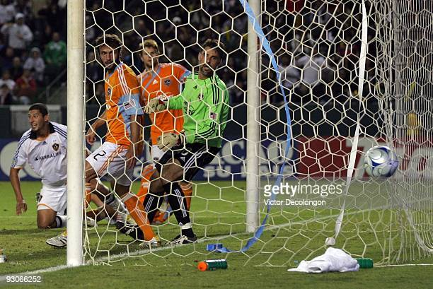 Goalkeeper Pat Onstad and defender Eddie Robinson of the Houston Dynamo can only watch as the ball goes in the net for a goal by Gregg Berhalter of...