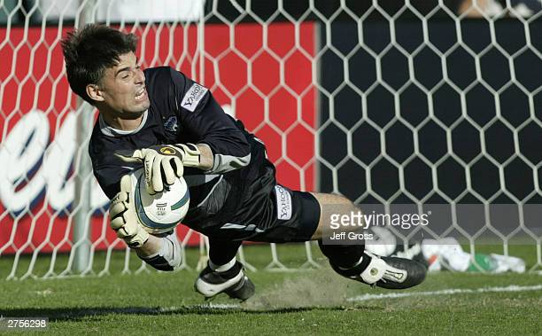 Goalkeeper Pat Onstad of the San Jose Earthquakes stops a penalty kick by the Chicago Fire that would have tied the game in the second half of the...