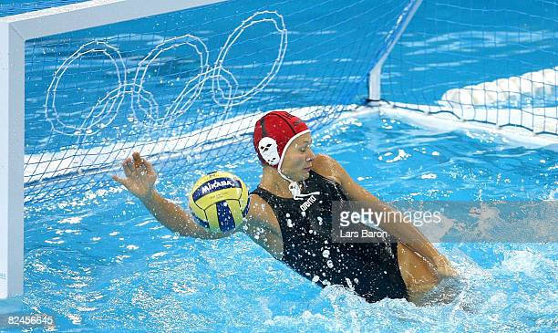 Goalkeeper Patricia Horvath of Hungary defends the goal over the Netherlands during the women's water polo semifinal round at the Ying Tung...