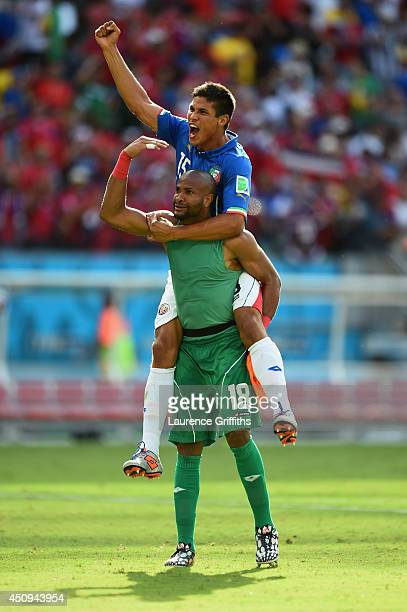 Goalkeeper Patrick Pemberton of Costa Rica celebrates with teammate Oscar Granados after defeating Italy 1-0 during the 2014 FIFA World Cup Brazil...
