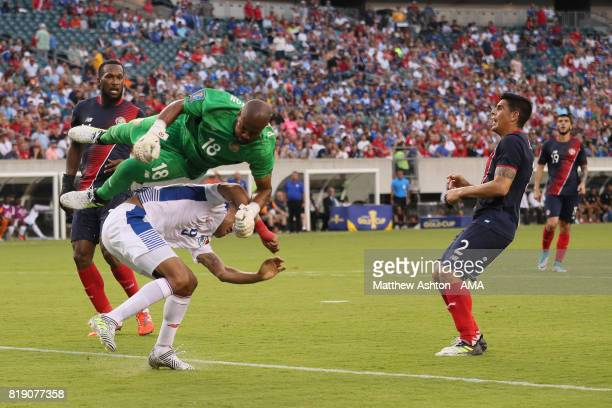 Goalkeeper Patrick Pemberton of Costa Rica goes over Gabriel Torres of Panama during the 2017 CONCACAF Gold Cup Quarter Final match between Costa...