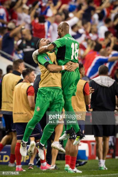 Goalkeeper Patrick Pemberton of Costa Rica goes over to the sidelines to celebrate the goal during the Group A CONCACAF Gold Cup Match between...
