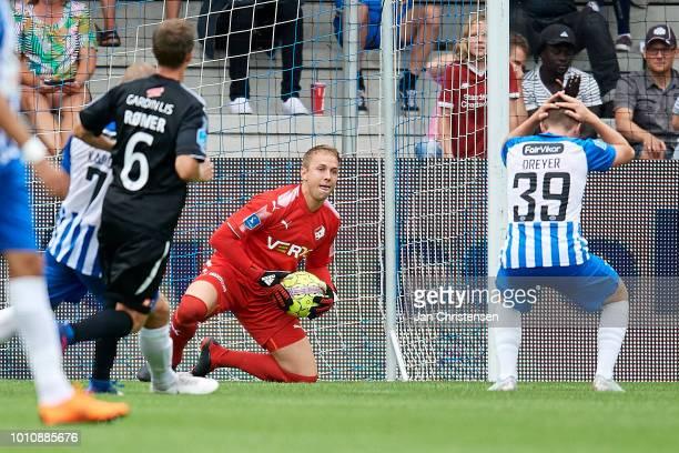 Goalkeeper Patrik Carlgren of Randers FC save a penalty kick from Anders Dreyer of Esbjerg fB during the Danish Superliga match between Esbjerg fB...