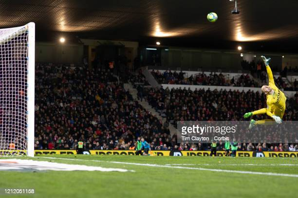 February 28: Goalkeeper Paul Bernardoni of Nimes dives to cover a shot which went over the bar during the Nimes V Marseille, French Ligue 1, regular...
