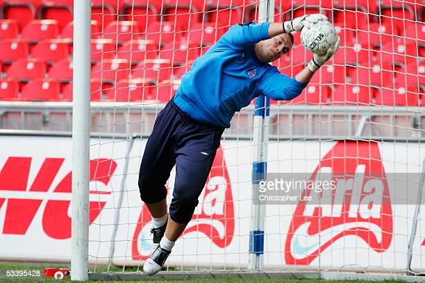 Goalkeeper Paul Robinson dives during the England Training Session at the Parken Stadium on August 16 2005 in Copenhagen Denmark