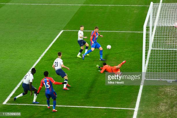 Goalkeeper Paulo Gazzaniga of Tottenham Hotspur knocks the ball into the path of Connor Wickham of Crystal Palace who scores the opening goal during...