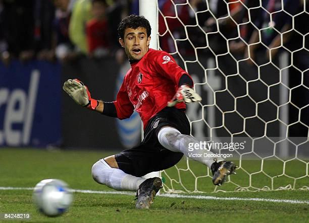 Goalkeeper Pedro Hernandez of Atlas watches the ball go into the net during penalty kicks in their InterLiga match against Pachuca FC at The Home...