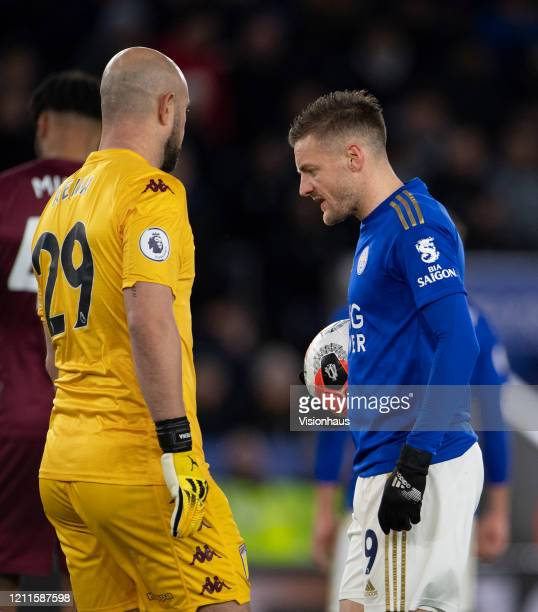 Goalkeeper Pepe Reina of Aston Villa approaches Jamie Vardy of Leicester before Vardy takes and scores a penalty during the Premier League match...