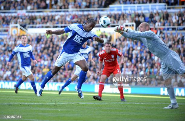 Goalkeeper Pepe Reina of Liverpool and Cameron Jerome of Birmingham City in action during the Barclays Premier League match between Birmingham City...