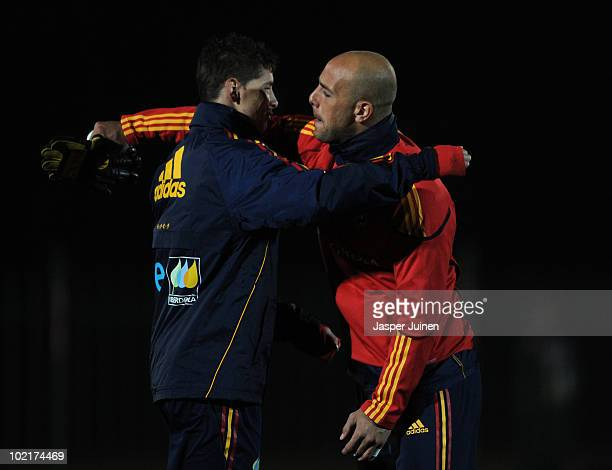 Goalkeeper Pepe Reina of Spain embraces his teammate Fernando Torres during a training session on the day after Spain's defeat against Switzerland on...