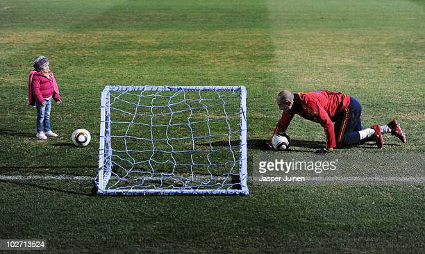 Goalkeeper Pepe Reina of Spain plays football with his daughter Grecia at the end of a training session ahead of their World Cup 2010 Final match...