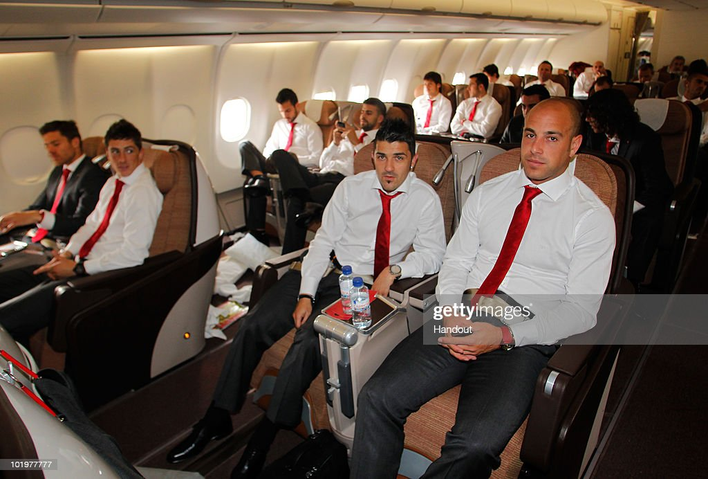 Goalkeeper Pepe Reina of Spain sits next to his teammate David Villa shortly after touch down at Johannesburg airport on June 11, 2010 in Johannesburg, South Africa.