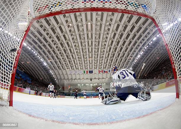 Goalkeeper Peter Budaj of Slovaki fails to stop the goal by Brian Rolston during the first period to tie the game 11 during men's ice hockey...