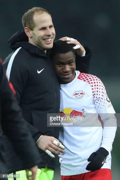 Goalkeeper Peter Gulacsi of Leipzig embraces Ademola Lookman of Leipzig after the Bundesliga match between Borussia Moenchengladbach and RB Leipzig...