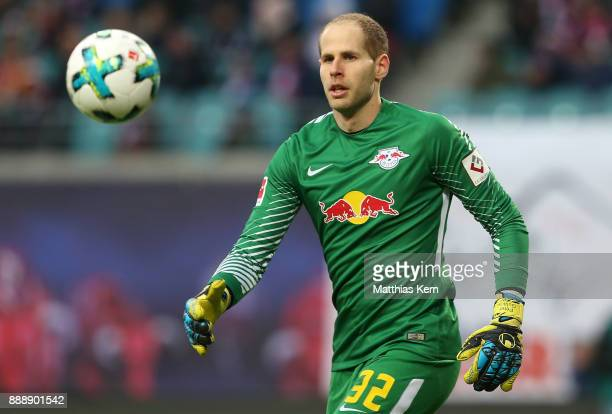 Goalkeeper Peter Gulacsi of Leipzig looks to the ball during the Bundesliga match between RB Leipzig and 1FSV Mainz 05 at Red Bull Arena on December...