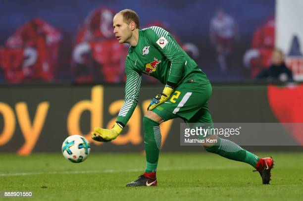 Goalkeeper Peter Gulacsi of Leipzig throws the ball during the Bundesliga match between RB Leipzig and 1FSV Mainz 05 at Red Bull Arena on December 9...