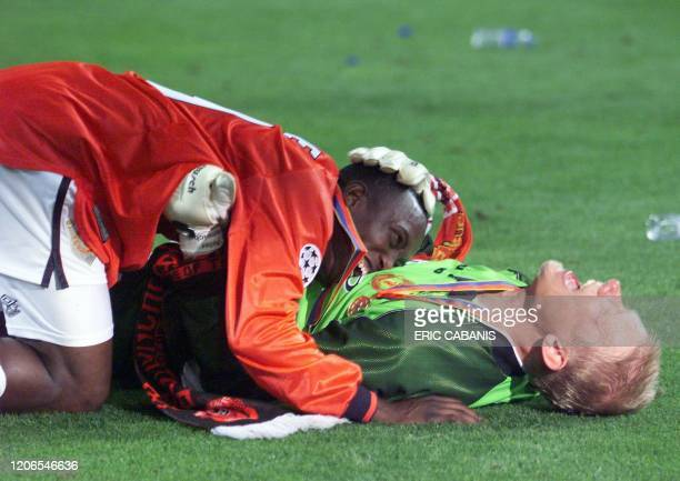 Goalkeeper Peter Schmeichel and forward Dwight Yorke of Manchester United jubilate after winning the final of the soccer Champions League against...