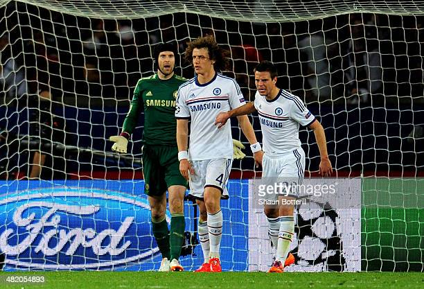 Goalkeeper Petr Cech looks on in disbelief after David Luiz of Chelsea scores an own goal to give PSG a 2-1 lead during the UEFA Champions League...
