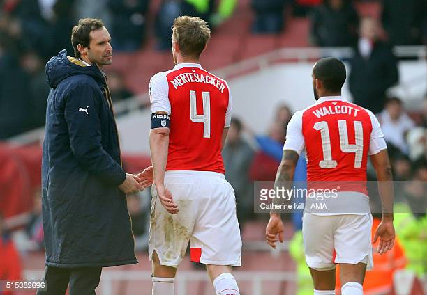 Goalkeeper Petr Cech of Arsenal consoles team mates Per Mertesacker and Theo Walcott after the Emirates FA Cup match between Arsenal and Watford at...