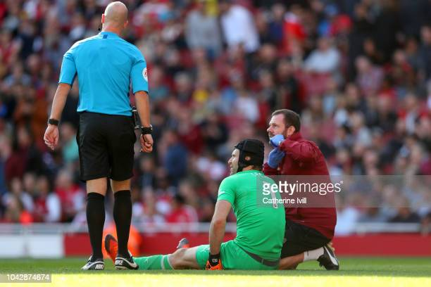 goalkeeper Petr Cech of Arsenal receives treatment prior to being substitued for an injury during the Premier League match between Arsenal FC and...