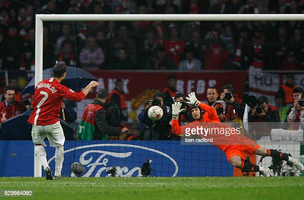 Goalkeeper Petr Cech of Chelsea dives and saves Cristiano Ronaldo's penalty kick of Manchester United during the UEFA Champions League Final between...