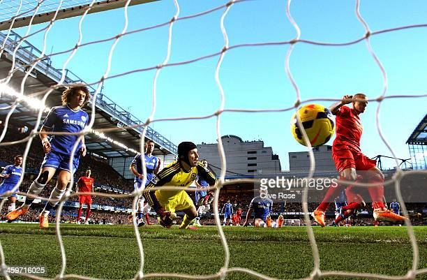 Goalkeeper Petr Cech of Chelsea dives at the ball as Martin Skrtel of Liverpool scores the opening goal during the Barclays Premier League match...