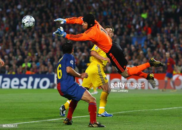Goalkeeper Petr Cech of Chelsea jumps to claim a ball from Xavi Hernandez of Barcelona during the UEFA Champions League Semi Final First Leg match...