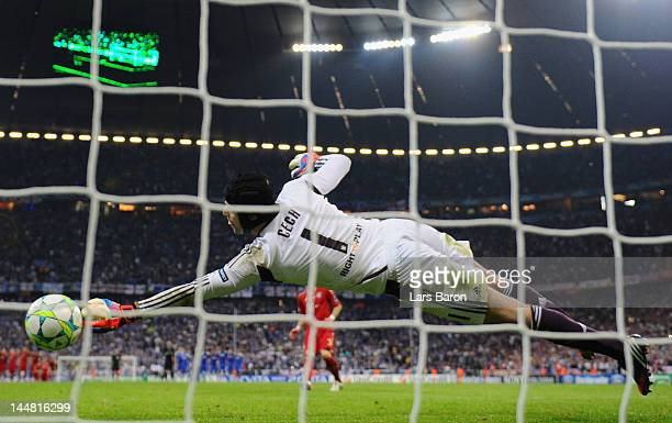 Goalkeeper Petr Cech of Chelsea saves a penalty by Bastian Schweinsteiger of Bayern Muenchen dujring the penalty shoot out during UEFA Champions...