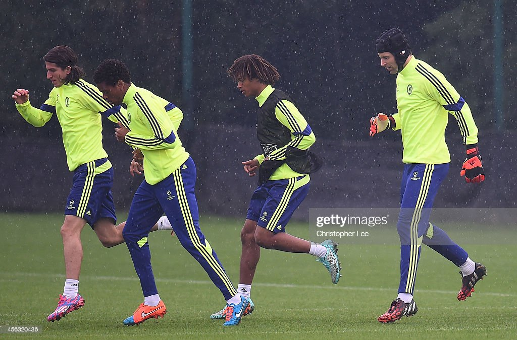 Goalkeeper Petr Cech (R) warms up during the Chelsea Training Session at Chelsea Training Ground on September 29, 2014 in Cobham, England.