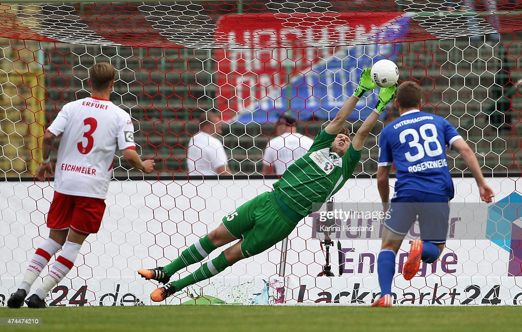 Goalkeeper Philipp Klewin of Erfurt saves the ball, Marco Rosenzweig of Unterhaching without a chance during the Third League match between FC Rot Weiss Erfurt and SpVgg Unterhaching at Steigerwaldstadion on May 23, 2015 in Erfurt, Germany.