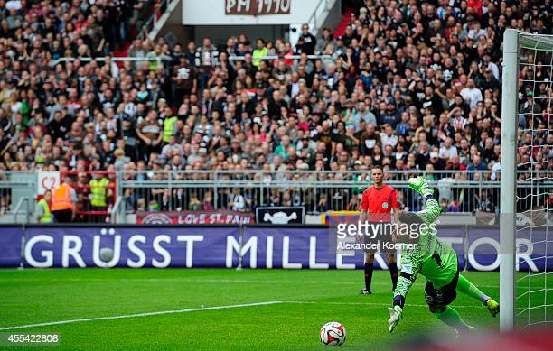 Goalkeeper Philipp Tschauner of FC St Pauli can not reach the a shot of TSV 1860 Muenchen's Leonardo Vitor Santiago during the Second league match...
