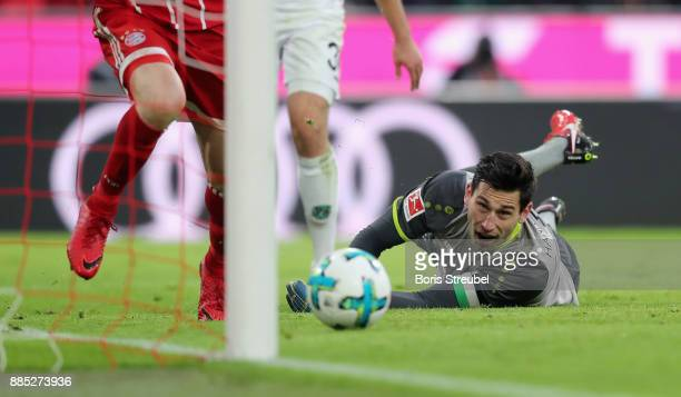 Goalkeeper Philipp Tschauner of Hannover 96 looks after the ball during the Bundesliga match between FC Bayern Muenchen and Hannover 96 at Allianz...