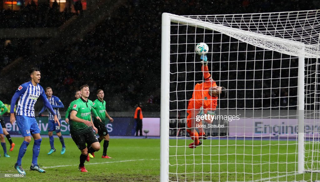 Goalkeeper Philipp Tschauner of Hannover 96 saves the ball during the Bundesliga match between Hertha BSC and Hannover 96 at Olympiastadion on December 13, 2017 in Berlin, Germany.