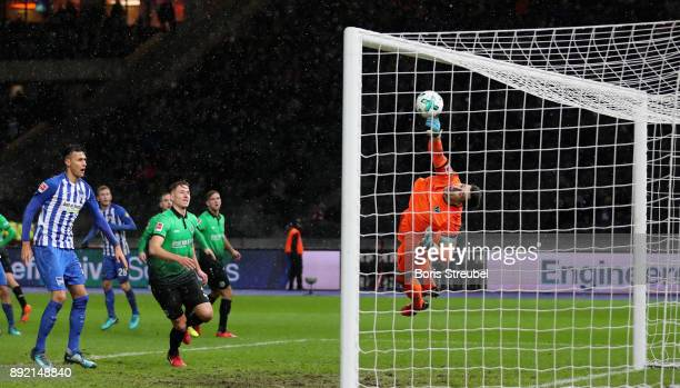 Goalkeeper Philipp Tschauner of Hannover 96 saves the ball during the Bundesliga match between Hertha BSC and Hannover 96 at Olympiastadion on...