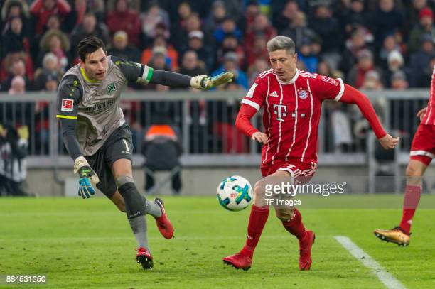 Goalkeeper Philipp Tschauner of Hannover and Robert Lewandowski of Bayern Muenchen battle for the ball during the Bundesliga match between FC Bayern...