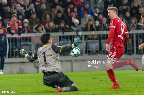 Goalkeeper Philipp Tschauner of Hannover and Robert Lewandowski of Bayern Muenchen in action during the Bundesliga match between FC Bayern Muenchen...