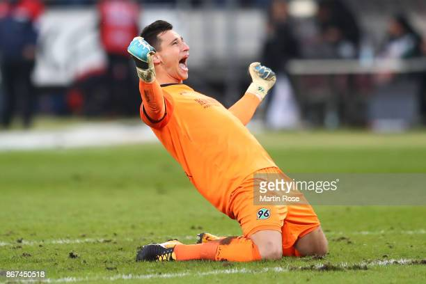 Goalkeeper Philipp Tschauner of Hannover celebrates his teams fourth goal during the Bundesliga match between Hannover 96 and Borussia Dortmund at...