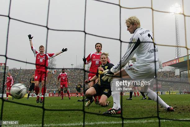 Goalkeeper Phillip Heerwagen makes a save against Sascha Roesler of Aachen during the Second Bundesliga match between Alemannia Aachen and Spvgg...