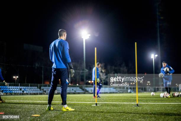 goalkeeper practicing on soccer training - football training stock pictures, royalty-free photos & images