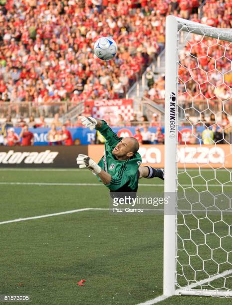Goalkeeper Preston Burpo of the Colorado Rapids just misses the ball which hit the post during the game against Toronto FC on June 14, 2008 at BMO...