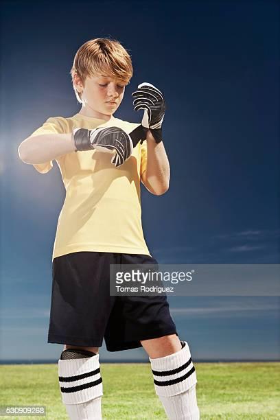 Goalkeeper putting on gloves