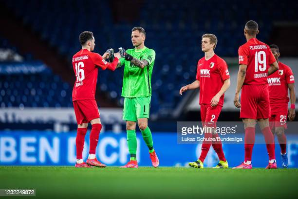 Goalkeeper Rafat Gikiewicz of Augsburg shakes hands with Ruben Vargas and team mates during the Bundesliga match between FC Schalke 04 and FC...