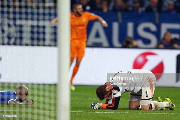 Goalkeeper Ralf Faehrmann and Felipe Santana of Schalke react as Karim Benzema of Madrid celebrates his team's fourth goalduring the UEFA Champions...
